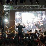 Orquesta Juvenil del Sodre en el puerto de la ciudad de Salto