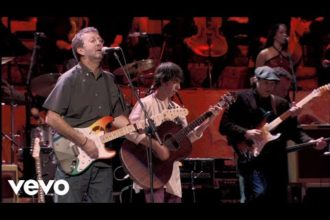 Paul McCartney, Eric Clapton performing While My Guitar Gently Weeps